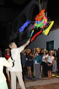 Woman hitting pinata in Mexico